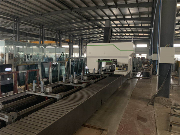 Unit type curtain wall four axis processing center