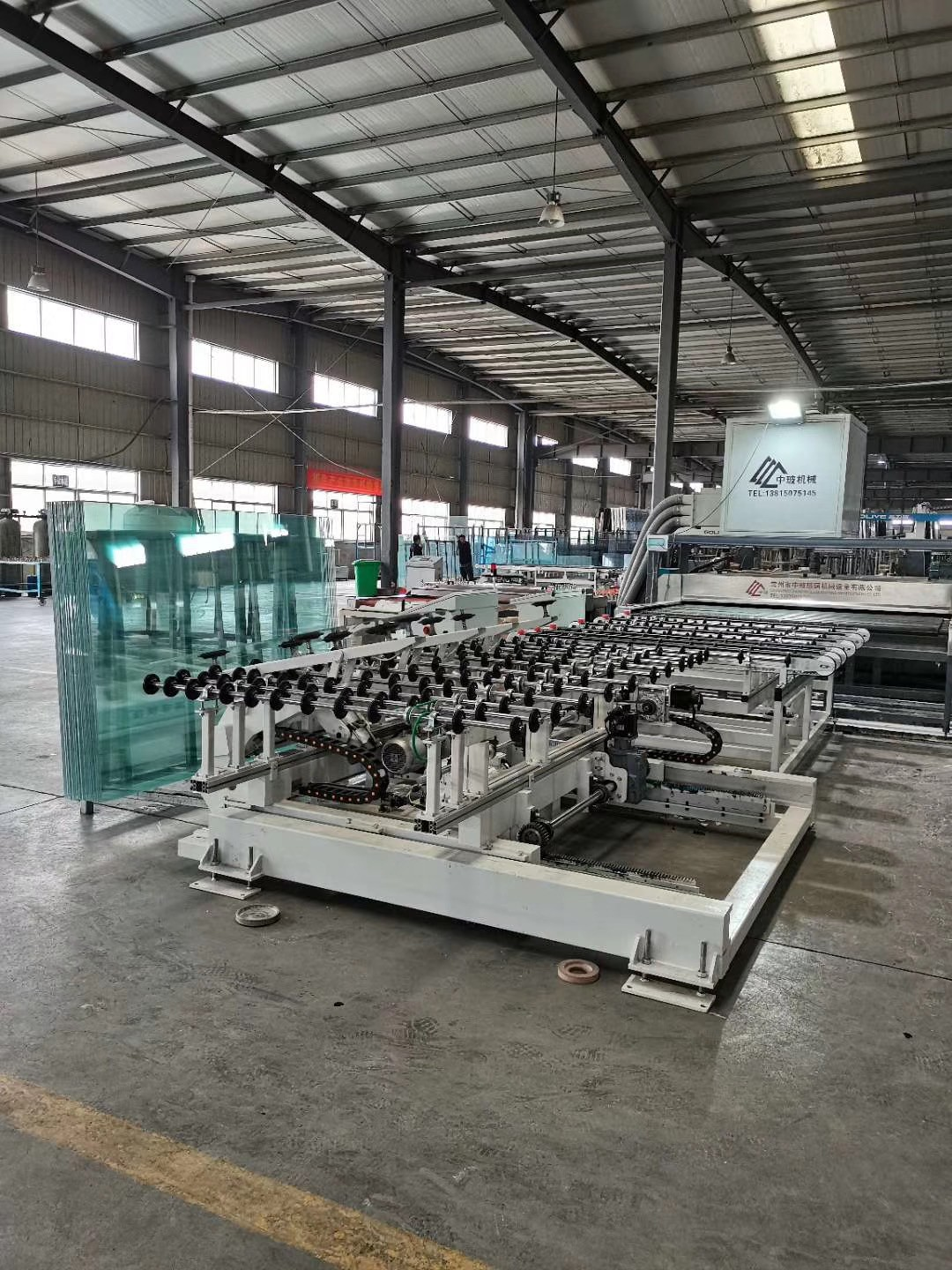 AUTOMATIC LOADING AND OFF LOADING EDGING MACHINE 1